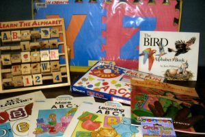 Helps children learn their A-B-C's. Kit includes felt letters, floor puzzle, rotating alphabet blocks as well as books.
