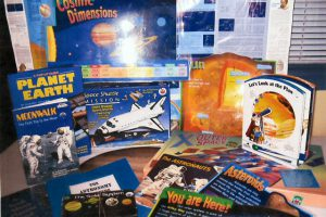 The budding astronomer will love this kit. It includes a solar system puzzle, books, games, experiments, teachers guide book, binoculars.