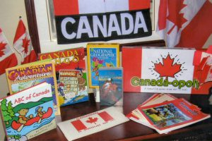 """Celebrate Canada and Ontario. Includes laminated Canadian adventure poster and Ontario Parks poster, National Geographic software, a beautiful video entitled """"Our Canada - An Aerial Adventure,"""" Canadian flag and bag, wipe off map, and activity sheets."""