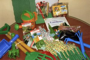 """For the """"budding"""" gardener. Kit has a Spring Sowing Kit, gardening gloves, shovels, kneeling mats, trowels, and watering pots as well as wonderful green thumb books and activity flyers."""