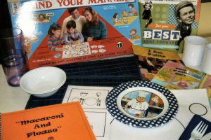 """This is a very new addition to the kit list! It includes a """"Mind Your Manners"""" game, placemats and utensils, manners lessons (Macaroni & Please!), books and more!"""